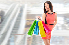 Young woman with bags in shopping mall Royalty Free Stock Photos