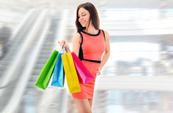 Young woman with bags in shopping mall Stock Images