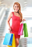 Young woman with bags in shopping mall.  Royalty Free Stock Photo