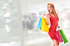 Young woman with bags in shopping mall Royalty Free Stock Photo