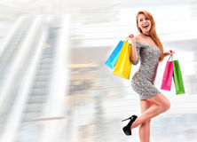 Young woman with bags in shopping mall Royalty Free Stock Photography