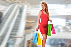 Young woman with bags in shopping mall Royalty Free Stock Image