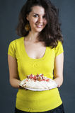 Young woman baker. Holding a fresh pavlova royalty free stock images