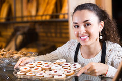 Young woman at bakery display Stock Images