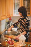 Young woman baking christmas cookies at the decorated kitchen Royalty Free Stock Photo