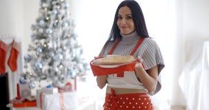 Young woman baking Christmas treats Royalty Free Stock Image