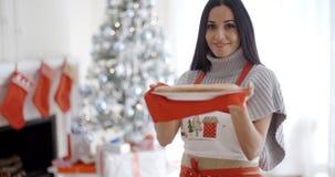 Young woman baking Christmas treats Royalty Free Stock Photo