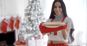 Young woman baking Christmas treats stock video footage