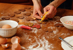 Young woman baking gingerbread at home Royalty Free Stock Image