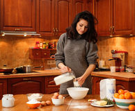 Young woman baking at home Royalty Free Stock Photo