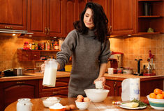 Young woman baking at home Royalty Free Stock Photography