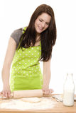 Young woman baking with rolling pin Royalty Free Stock Image