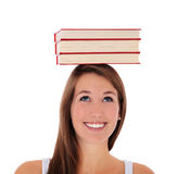 Young woman balancing books on her head Stock Images