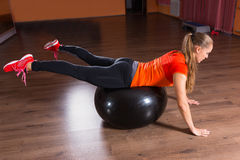 Young Woman Balancing on Exercise Ball in Studio Stock Images