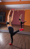 Young Woman Balancing on One Leg in Dance Studio Royalty Free Stock Images