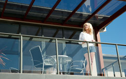 Young woman on balcony Royalty Free Stock Photos