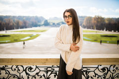 Young woman on balkon of house on park background Stock Photos