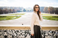 Young woman on balkon of house on park background Royalty Free Stock Image