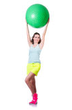 Young woman with ball exercising Royalty Free Stock Photography