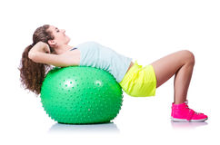 Young woman with ball exercising Stock Photo