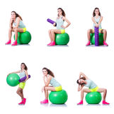The young woman with ball exercising on white Royalty Free Stock Photography