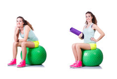 The young woman with ball exercising on white Stock Photography