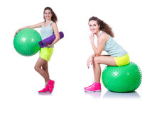 The young woman with ball exercising on white Royalty Free Stock Photo