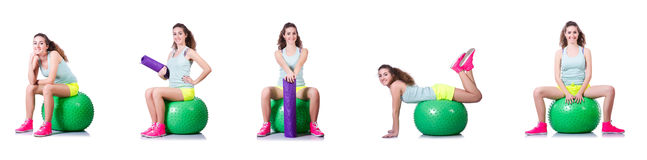 The young woman with ball exercising on white Royalty Free Stock Photos