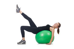 Young woman with ball exercising Stock Photography