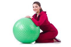 Young woman with ball exercising Royalty Free Stock Images