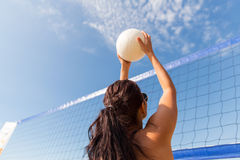 Young woman with ball playing volleyball on beach Royalty Free Stock Image