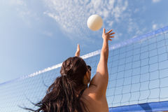 Young woman with ball playing volleyball on beach Royalty Free Stock Photos