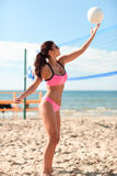 Young woman with ball playing volleyball on beach stock photos