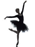Young woman ballerina ballet dancer dancing. One caucasian young woman ballerina ballet dancer dancing with tutu in silhouette studio on white background royalty free stock photos