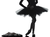 Young woman ballerina ballet dancer dancing silhouette Royalty Free Stock Images