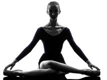 Young woman ballerina ballet stretching warming up Royalty Free Stock Images