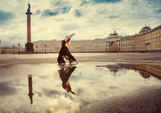 The young woman, the ballerina dances on the square Royalty Free Stock Photos
