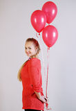 Young woman with balloons Stock Image