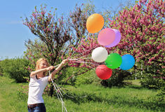 Young woman with balloons. Freedom, happiness, carefree concept Stock Photo