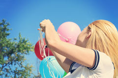 Young woman with balloons. Freedom, happiness, carefree concept Royalty Free Stock Image