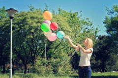Young woman with balloons. Freedom, happiness, carefree concept. Vintage image Stock Images