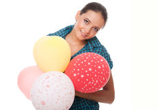Young woman with balloons for happy birthday. Smiling young woman with balloons for happy birthday over white background Stock Photo
