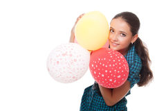 Young woman with balloons for happy birthday. Lovely young woman with balloons for happy birthday over white background Royalty Free Stock Image