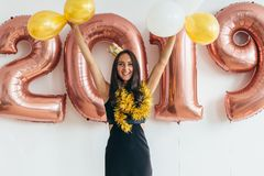 Young woman with balloons posing celebrating New Year Stock Images