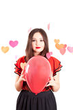 Young woman with baloon. Attractive young woman with baloon on Valentine's day Stock Photography