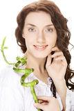 Young woman with bamboo. Stock Photography