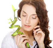 Young woman with bamboo. Stock Photo