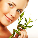 Young woman with a bamboo plant Royalty Free Stock Photo