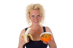 Young woman with banana and cornflakes Royalty Free Stock Photos