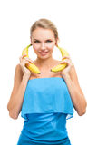 Young woman with bananas in her hands Stock Photography